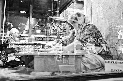 Women preparing food in a window